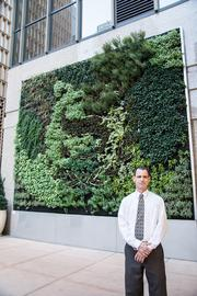 Shane Morton, CEO of Brighton-based UnusualGreen, stands in front of the vertical garden outside the Sheraton Downtown Denver Hotel. Morton worked with renowned Spanish architectural firm Urbanarbolismo, which does business as Urban Green in the United States, to design the greenery in time for the Mile High Gardening Conference that was held in June.