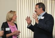 Suzie Boland, RFB Communications and Howard Sachs, Raymond James Financial speak before lunch.