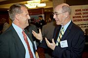 A CFO of the Year honoree Nick Malone of Wayfair, left, listens to George Couldter of CBIZ Tofias as they converse during the networking portion of the Boston Business Journal's CFO Awards luncheon.