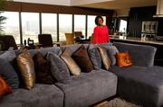 Houston designer Angela Lee at Casey Hampton's high-rise Houston home.