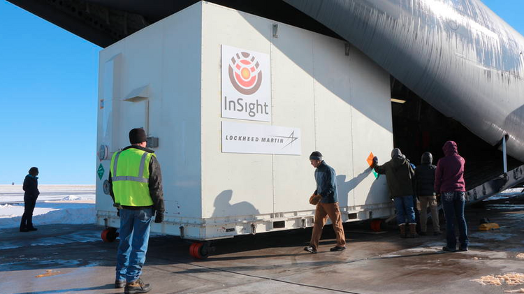 In a 2015 file photo, NASA's Mars-bound InSight spacecraft is loaded into a C-17 cargo aircraft at Buckley Air Force Base that was bound for Vandenberg Air Force Base, California. The spacecraft, built by Lockheed Martin Space Systems, was scheduled for launch that year but was delayed and is now slated to take off May 5, 2018.