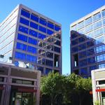 Local investment group snaps up second Uptown tower