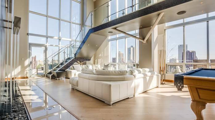 $50,000 broker bonus offered to help sell downtown condo with its own waterfall
