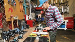 Aaron Mathers, a design engineer at K2 Sports, drills binding holes on in-production alpine ski at K2's development center in South Seattle, Wash. on Oct. 1 2015.