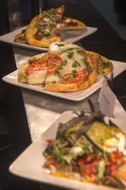New artisan flat bread pizzas will be on the menu this season on the club level of M&T Bank Stadium. Selections include a Margherita pizza with basil pesto and a Sweet Italian Sausage.