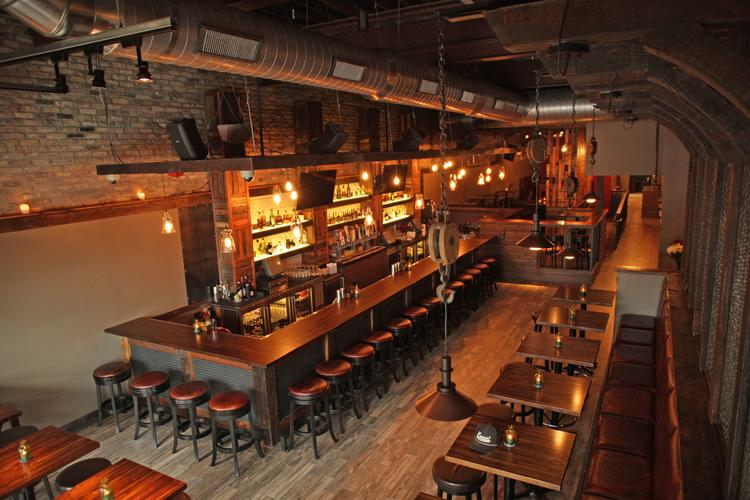 The decor at Ugly's Pub in downtown Milwaukee features reclaimed wood and  brick. - Ugly's Pub Opens In Downtown Milwaukee - Milwaukee - Milwaukee
