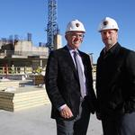 Developers celebrate 'sky breaking' for 22-story hotel tower above EpiCentre