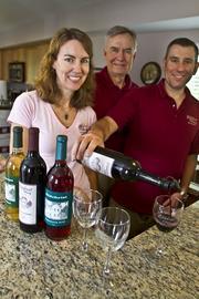Jennifer Eldredge, her father Steve Rennick and husband Chris Eldredge run Eldchrist Winery in Plain City.