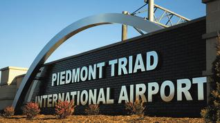 What should be the Triad airport's name?