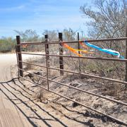 "A gate inside the Eagle Ford is ""flagged"" to identify it for work crews. Leases with oil companies can stipulate anything from where oil companies can enter property to what natural features they must steer clear of."