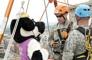 Mrs. Chikin was briefed about safety prior to rappelling off the Hyatt roof.
