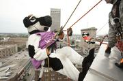 Mrs. and Mr. Chikin going Over the Edge for the scouts fund-raising event.