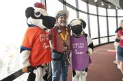 Cousin Willie, of Cousin Willie's Original Popcorn, posed with Mr. and Mrs. Chikin, mascots for Chick-fil-A, in the Spires restaurant, where they were preparing for the rappelling event.
