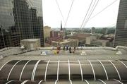 A rappeling team is shown from the Spires restaurant at the downtown Hyatt.