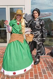 Becky Zarrella (left), as Apple Jack from My Little Pony, and Cassie Lowell, costumed as Kirito from Sword Art Online, wait outside the convention center for the start of Otakon Friday morning. The Frederick residents brought several costumes each — Lowell has seven and Zarrella has three — to change characters throughout the weekend convention.