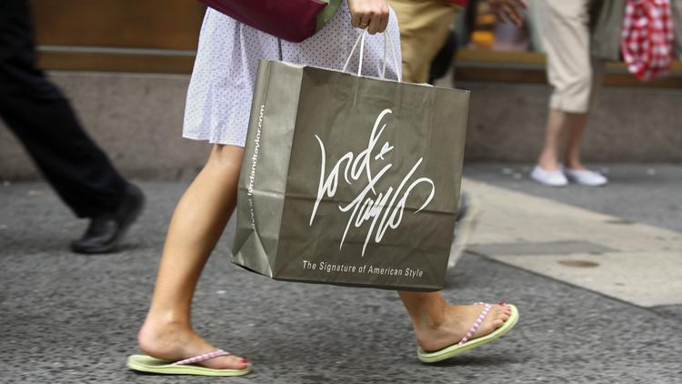 b7ac4827bdf A customer carries a Lord   Taylor shopping bag in New York. Photographer   Adam