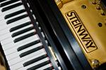 Lee's Summit piano shop owner charged with stealing from customers