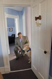 Lily goes to work with attorney David LIttman. Photo by Kathleen Lavine 3/13