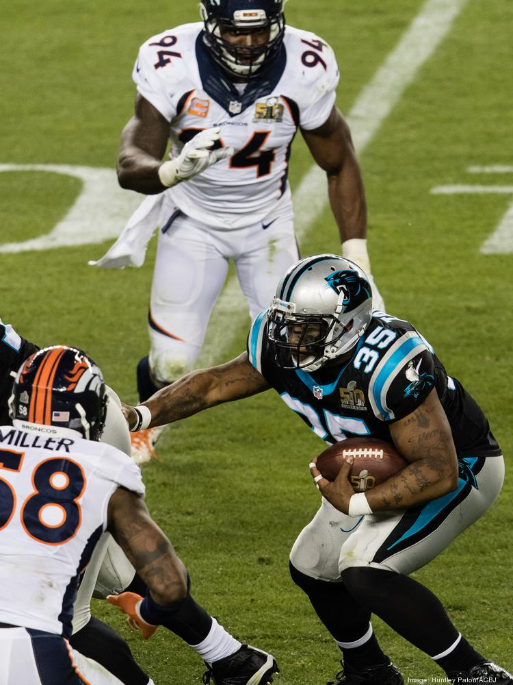 Denver Broncos defensive end DeMarcus Ware (top, 94) and linebacker Von Miller (left, 58) and close in on Carolina Panthers fullback Mike Tolbert (35) in Super Bowl 50 at Levi's Stadium in February 2016. The Broncos won 24-10.