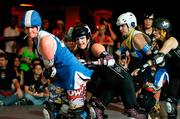 Amy Dinn (No. 35) in action during a roller derby match.
