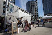 Entertainers and street vendors set up in the heart of South Waterfront, giving residents and area workers alike a place to gather.