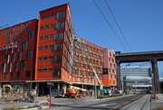 The 118-unit Emery apartments — ie the orange structure rising to the south of the Ross Island bridge — represents the Zidell Company's first stab at redeveloping about 33 of the acres attached to its barge-making plant on the Willamette River.
