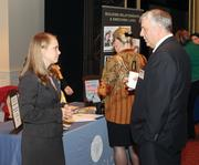 Rivers Club's Alaina Krupa chats with James Chiafullo of Cohen & Grigsby, P.C. at the Rivers Club's trade show table.
