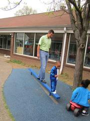 Humana CEO Bruce Broussard interacts with children at the Oak & Acorn Intergenerational Center during a volunteer day with other members of Humana's Executive Team.