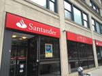 Santander's loan levels drop off as local rivals grow