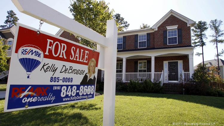 A Re/Max International Inc. for sale sign is displayed outside of a home in Durham, North Carolina, U.S., on Sunday, Oct. 16, 2011. Home sales in North Texas are setting records. Photographer: Jim R. Bounds/Bloomberg