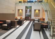 A lobby on the third floor, with a mosaic by Michael Sweere.