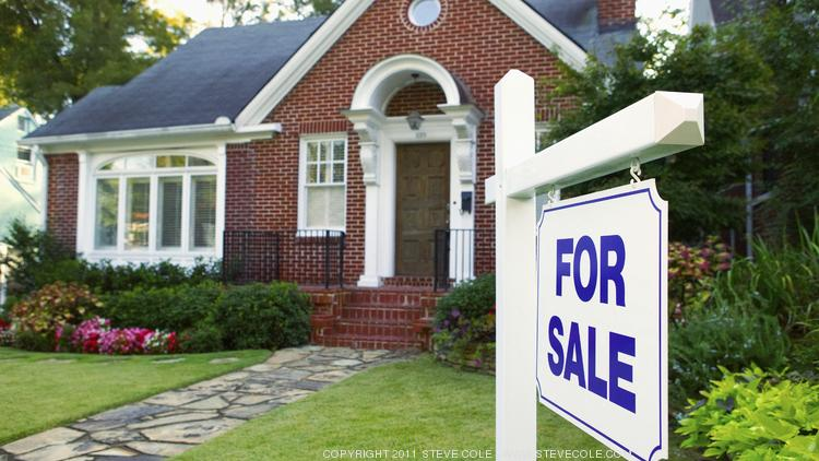 Home prices in North Texas could be overvalued by as much as 14 percent, according to a Fitch Ratings report.