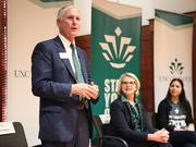 UNC Charlotte Chancellor Phil Dubois introduces UNC System President Margaret Spellings at a meeting on campus on Monday.