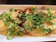 Corn ravioli, fresh crab, English peas, melted tomatoes