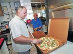 Pizza shop owner: Hand it to the students, they bring in the dough