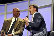 Former quarterback Jake Delhomme jokes with Eugene Robinson, a former player who now works as a radio analyst on Panthers games.