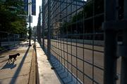 Steel fences line the race course along Pratt Street. More than 130,000 people are expected to attend the Aug. 30-Sept. 1 Grand Prix of Baltimore.