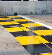 The start line along Pratt Street is painted in the city's signature yellow and black colors.