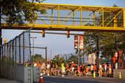 Yellow bridges, like the one above on Conway Street, have again been assembled along the course to allow pedestrians to cross the course during race.