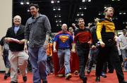Rocky Monk of Orlando sported a Superman shirt and cape as he was among the first in the door on the second day of MegaCon 2013.