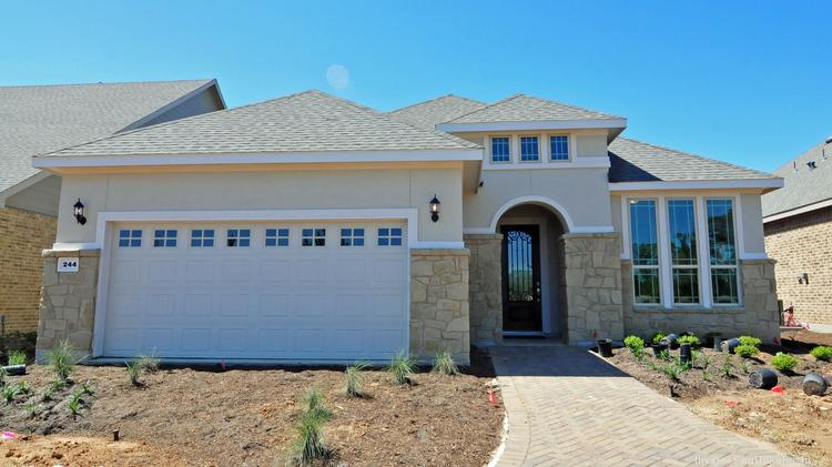 A model home in Del Webb The Woodlands, a new active adult community north  of