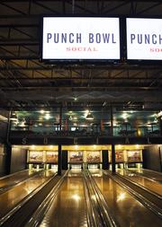 Bowling is just of of the attractions at Punch Bowl Social. You can also play pool, ping pong, marbles, shuffleboard, darts, foosball and a variety of vintage video games.