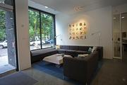 The lobby of ArtHouse overlooks both the North Park Blocks and an interior rain garden.