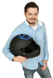 2013 PSBJ 40 under 40 honoree Jesse Proudman, CEO, Blue Box Group, Inc. Proudman holds the helmet he wears when he races cars.