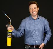 2013 PSBJ 40 under 40 honoree Matt Shea, EVP Product Development and Technology, at WildTangent.  Shea is know in his neighborhood and among friends and family for his 4th of July fireworks displays and uses this blow torch to light all the fuses.