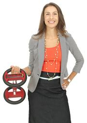 2013 PSBJ 40 under 40 honoree Rylie Teeter Leier, President and CEO, of Teeter / STL International Inc. Teeter Leier holds a 6 pound Thunderbell that her company makes.