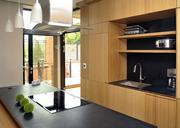 In the kitchen, the laminated bamboo cabinets also contain the refrigerator and the dishwasher.