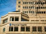 Premier 'to evaluate' future on health insurance exchange