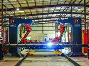 Prescient uses robotic welding, driven by the company's proprietary software, to manufacture pieces of buildings in its plant in Commerce City.
