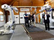 4DDI CEO Yiorgos Papaioannou, right, discusses the New Bolton Center's new robotic-controlled imaging system as Drs. Dean Richardson and Barbara Dallap Schaer stand by with 9-year-old bay mare Hevona.